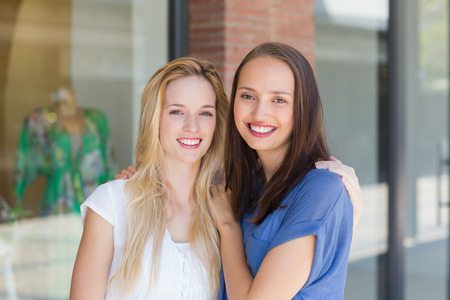 arms around: Portrait of smiling friends with arms around Stock Photo