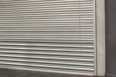 gritty: Closed grey shutters in the crossfit gym