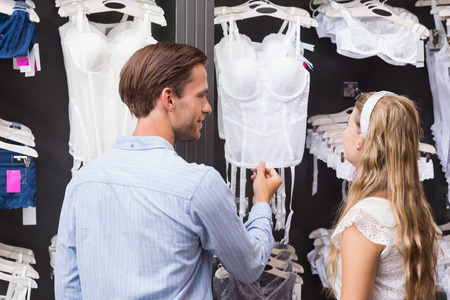 bodice: A man showing bodice to his girlfriend at the shopping mall