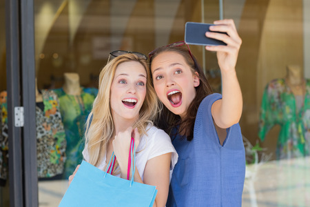 funny faces: Happy friends taking a selfie while doing funny faces