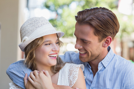 arms around: Cute smiling couple looking at each other with arms around Stock Photo