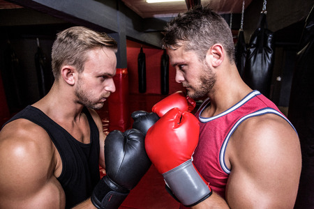 men exercising: Close up view of two boxing men exercising together