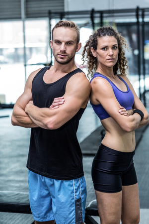 giving back: Portrait of a muscular couple giving back to back