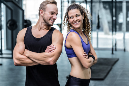 Back to back muscular couple looking at each other Stok Fotoğraf