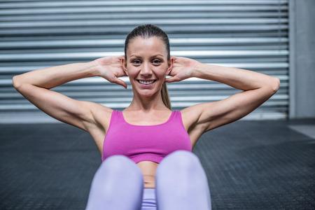 crunch: Portrait of a muscular woman doing abdominal crunch
