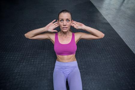 crunch: Upward view of muscular woman doing abdominal crunch Stock Photo