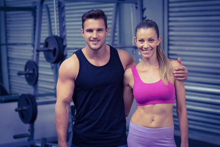 arms around: Portrait of a smiling muscular couple with arms around