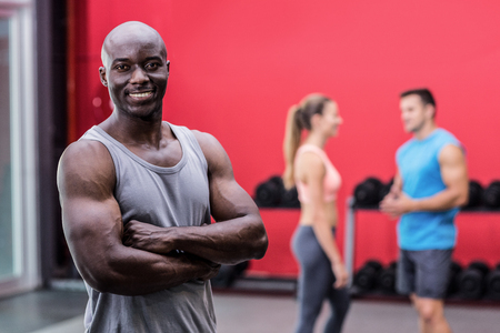 black men: Portrait of a smiling muscular man with arms crossed Stock Photo