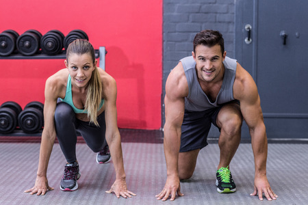 starting position: Portrait of a muscular couple on the starting position