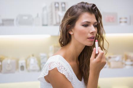 Woman testing lipstick at a beauty salon