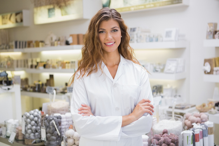 sellers: Portrait of smiling beautician at a beauty salon Stock Photo