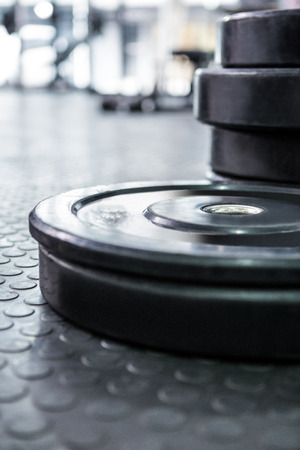 gritty: Close up view of weights in crossfit gym