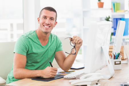 graphic tablet: Portrait of a young creative businessman drawing on graphic tablet Stock Photo