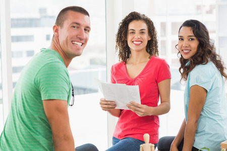 casual business: Casual business team having meeting in the office Stock Photo