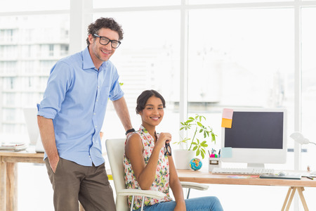 robo: Portrait of a smiling casual young couple at work in the office
