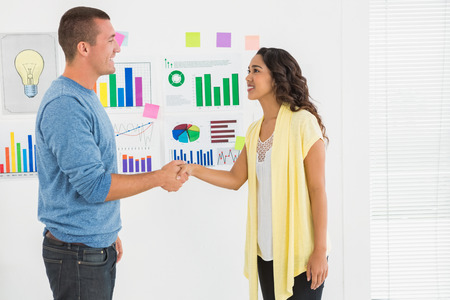 introducing: Portrait of business partners handshaking in the office Stock Photo