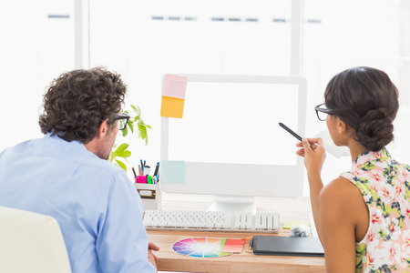 attentively: Thoughtful business coworkers working attentively in the office