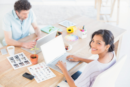 casual business: Casual business partners working on laptop in the office Stock Photo