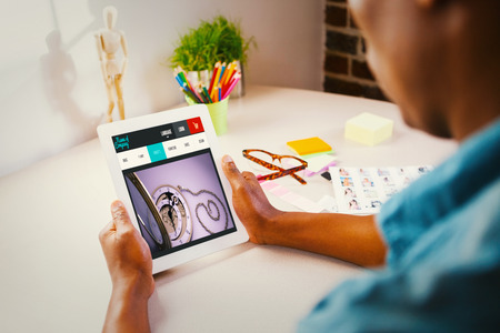 editor: Photo editor using tablet pc against website design Stock Photo