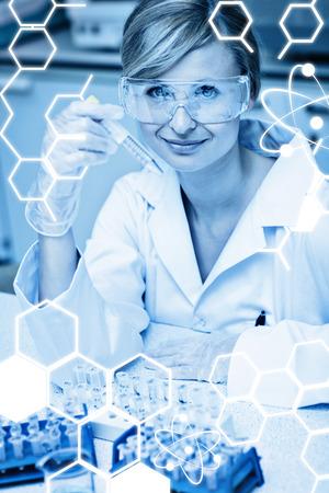 self assured: Science graphic against selfassured female scientist holding samples