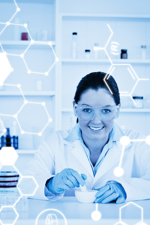 experimentation: Science graphic against smiling scientist preparing an experimentation