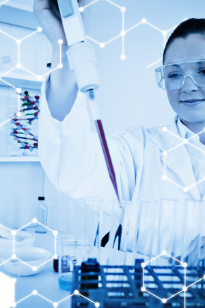 haematologists: Science graphic against cute female biologist holding a manual pipette with sample from test tubes