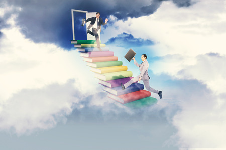 stern: Stern businessman in a hurry against blue sky over clouds at high altitude