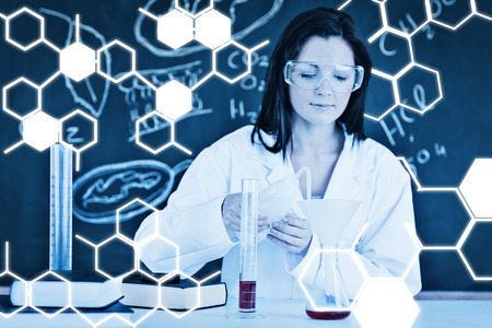 experimentation: Science graphic against beautiful scientist focusing on her experimentation