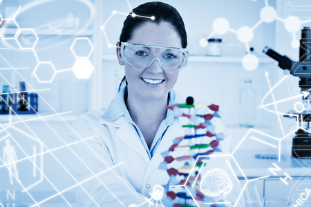 dna double helix: Science graphic against smiling scientist showing the dna double helix model