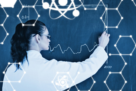 medical distribution: Science graphic against darkhaired scientist drawing a graph on the blackboard Stock Photo