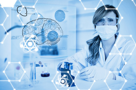 Science graphic against chemist working in protective suit with futuristic interface showing a brain Stock Photo