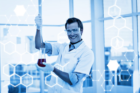testtube: Science graphic against science student examinig a testtube Stock Photo
