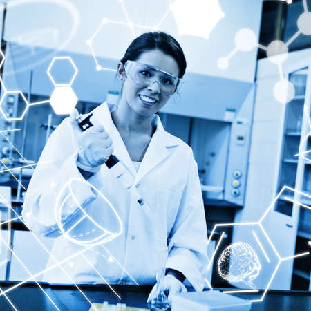 erlenmeyer: Science graphic against smiling scientist pouring a liquid in an erlenmeyer flask Stock Photo