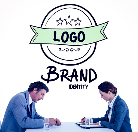 brand identity: Business people brainstorming together against brand identity doodle