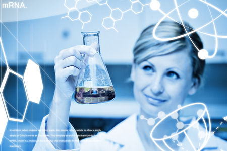 erlenmeyer: Science graphic against portrait of a concentrated female scientist looking at an erlenmeyer Stock Photo