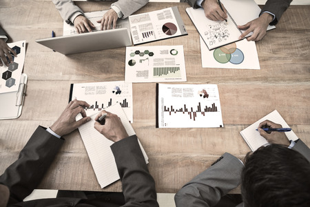 business executive: Brainstorm graphic against business interface with graphs and data Stock Photo