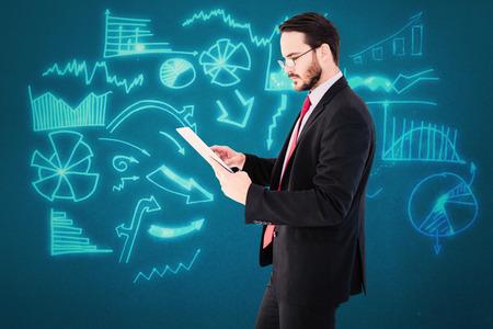 scrolling: Businessman scrolling on his digital tablet against blue background