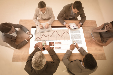 new technologies: Business interface against business people in meeting with new technologies
