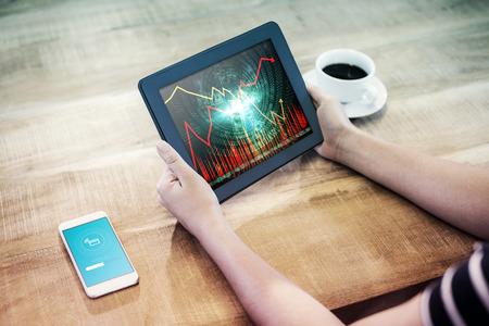 uploading: uploading screen against stocks and shares Stock Photo