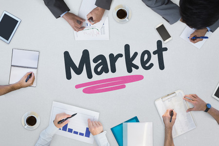 noting: The word market against business meeting Stock Photo