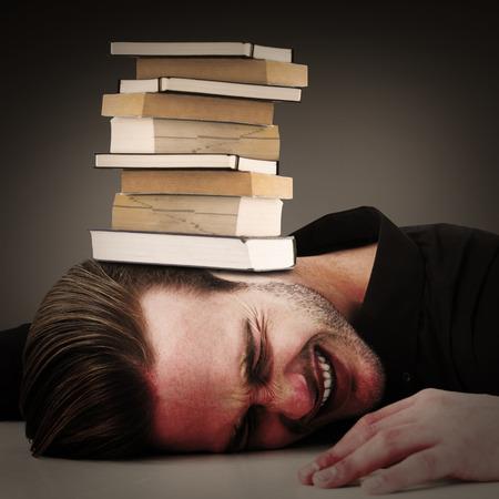 banging: Stressed businessman banging his head against grey vignette