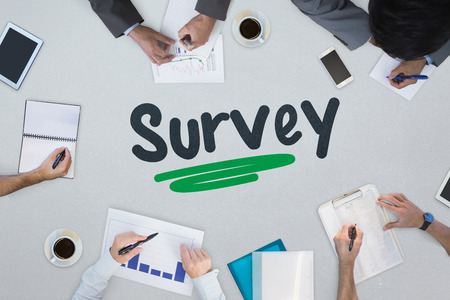 noting: The word survey against business meeting