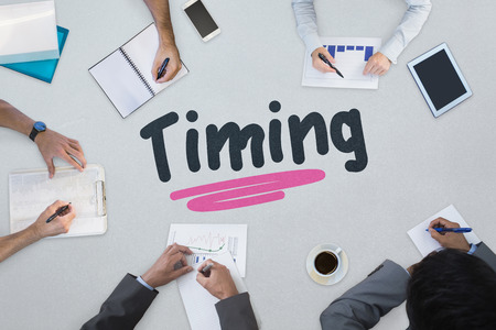 The word timing against business meeting Stock Photo
