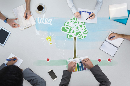 drawing a plan: Business meeting against idea tree Stock Photo