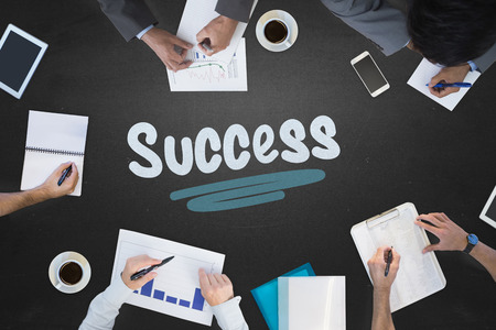 The word success and business meeting against blackboard
