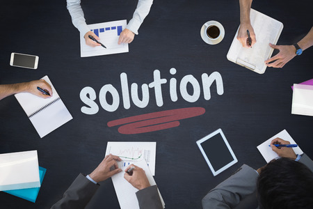 The word solution and business meeting against blackboard Stock Photo