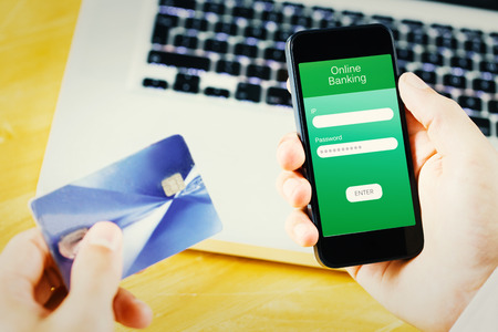 online banking: Businessman using smartphone against online banking Stock Photo