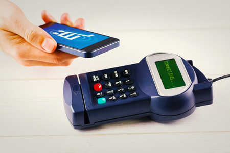 pin entry: Trolley against mobile payment Stock Photo
