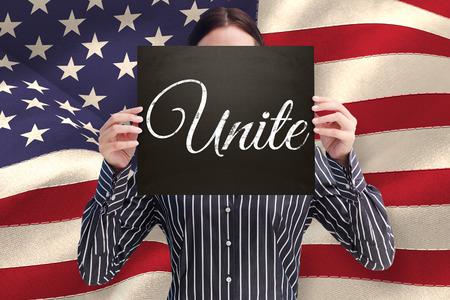 unite: Businesswoman showing board against unite