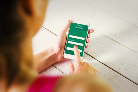 online banking: Woman using her smartphone against online banking Stock Photo